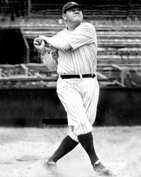 New York Yankees' Babe Ruth swinging his bat. Babe Ruth fol